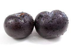Black plums Stock Images