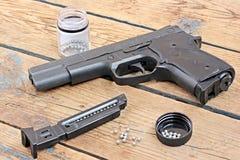 Black pneumatic gun. Black air (pneumatic ) gun on a timber floor stock photo