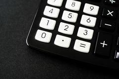 Black Pocket Calculator in office on black background stock photos