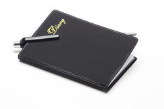 Black pocket diary and ballpoint pen Stock Photo