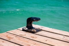 A black point for berthing a boat on a wooden jetty in Majorca beach Royalty Free Stock Photo