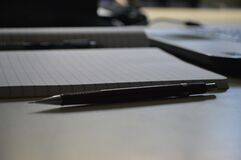 Black Point Pen Beside Ruled Paper Royalty Free Stock Photos