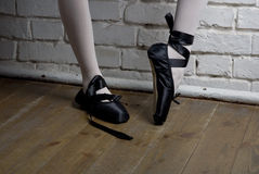 Black pointes. On the ballerina in white stockings Stock Image