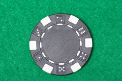 Black poker chip on the casino table Stock Image