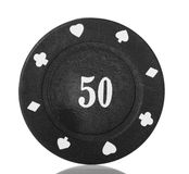 Black poker chip close-up isolated on white. Royalty Free Stock Images