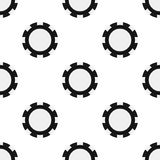 Black Poker Chip Icon Seamless Pattern. A seamless pattern with a black poker chip flat icon, isolated on white background. Useful also as design element for royalty free illustration