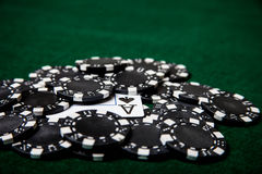 Black poker chip pile with ace of spades Royalty Free Stock Image