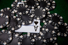 Black poker chip pile with ace of spades Royalty Free Stock Images