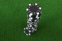 Black poker chips. A pile of black poker chips Stock Photo