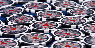 Black poker chips. On white background Stock Photo