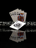 Black poker chips and cards. Ten to ace isolated on black background Stock Photography