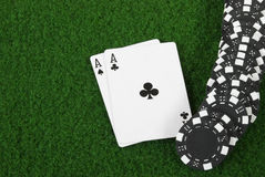 Black poker cihps and two aces. A Huge black pile of poker chips Royalty Free Stock Photos