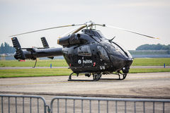 Black police helicopter. A Black Belgian MD-900 police helicopter with NOTAR (No Tail Rotor) design stock photo