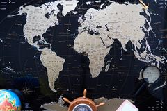 Black political map of the world. Still life of a traveler.  stock photos