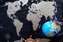 Black political map of the world. Still life of a traveler.  royalty free stock images