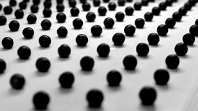 Black polka dots on white background. For desktop wallpaper and website design royalty free stock photos