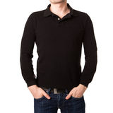 Black polo shirt with a long sleeve on a young man Stock Photo