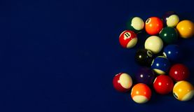 Black pool ball and a group of the rest of balls stock photos