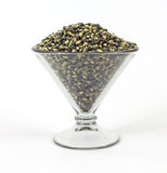 Black popcorn in a large martini shaped glass Stock Image