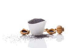 Black poppy seeds. Poppy seeds in white bowl on white background Royalty Free Stock Photography