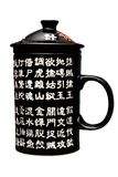 Black porcelain mug decorated with Chinese characters Royalty Free Stock Images