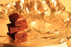 Black porous chocolate Stock Photos