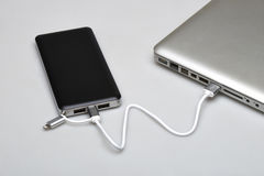 Black portable external power bank Royalty Free Stock Images
