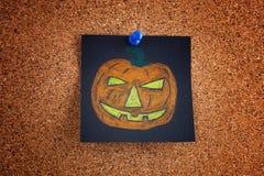 Black post it note with halloween pumpkin on bulletin board stock photos