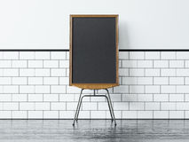 Black poster on the chair and white vintage wall Stock Images