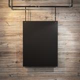 Black poster hanging on leather belt on wood background Stock Images