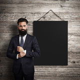 Black poster hanging leather belt on wood Royalty Free Stock Photography