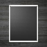 Black poster on the wooden wall Royalty Free Stock Photography