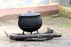 Black pot. A pot used by africans to cook food in Stock Image