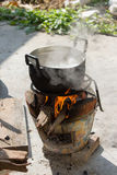 Black pot boiling water for cooking Royalty Free Stock Photo