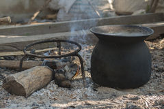 Black pot fire black pot sunrise iron boil outdoor royalty free stock image