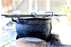 Black pot and firewood for cooking in the north of thailand, old pot black color Royalty Free Stock Images