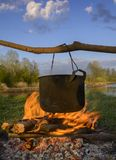 Black pot over fire Royalty Free Stock Photography