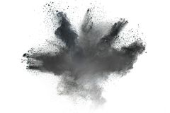 The particles of charcoal splattered on white background. Black powder explosion against white background.The particles of charcoal splattered on white Royalty Free Stock Photo