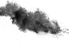 Black powder explosion. On white background. Abstract black dust texture on white background Royalty Free Stock Photo