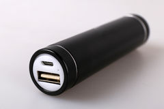 Black power bank for charging mobile devices Royalty Free Stock Photography