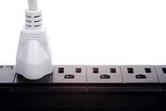 A black power strip with empty outlets Stock Photos