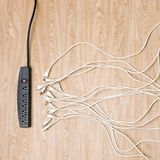 Black power strip white cords Royalty Free Stock Images