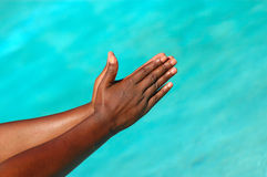 Black praying hands Stock Photo