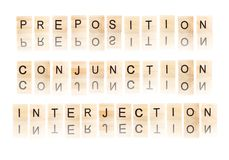 Verb and adjective word. Black preposition and conjunction and interjection word  with reflection, on wooden blocks on white background, Isolated Royalty Free Stock Photos