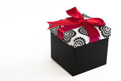 Black present with red ribbon Stock Photo