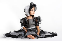 Black princess dress and bonnet. Cute little princess dressed in an old style english dress with a bonnet for halloween Royalty Free Stock Photography