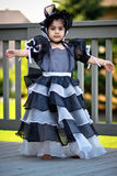 Black princess dress and bonnet. Cute little princess dressed in an old style english dress with a bonnet for halloween stock image