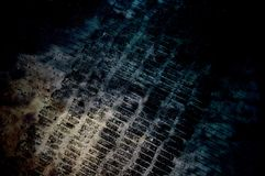 Black print on dark blue rustic wall. Old concrete texture in a dark room. A lot of scratches and cracks. Stock Photo