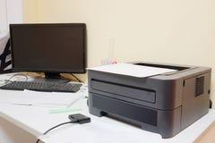 Black printer and paper closeup Stock Photos