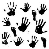 A set of prints of the hands and feet of an adult and a child. Vector illustration. Black prints of hands and feet. Traces of an adult and a child Stock Photo